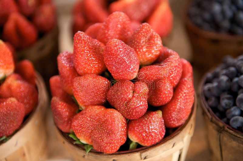 Fresh strawberries for sale in a basket stock photo
