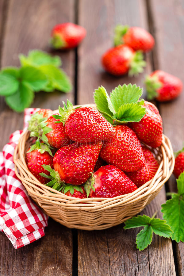 Fresh strawberry in basket royalty free stock photography