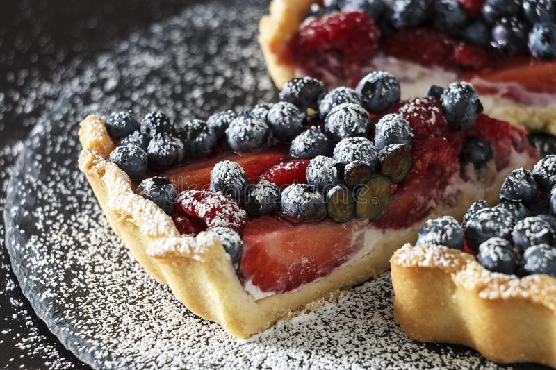 Fresh strawberry, blueberry and raspberry with ricotta tart cake. Selective focus royalty free stock images