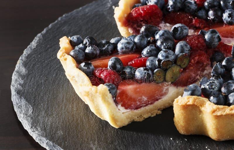 Fresh strawberry, blueberry and raspberry with ricotta tart cake. Selective focus stock photos