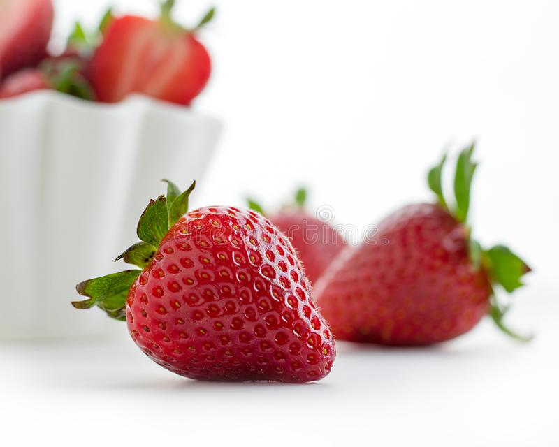 Fresh strawberry with leaves isolated on white backgrounds. - Image. 