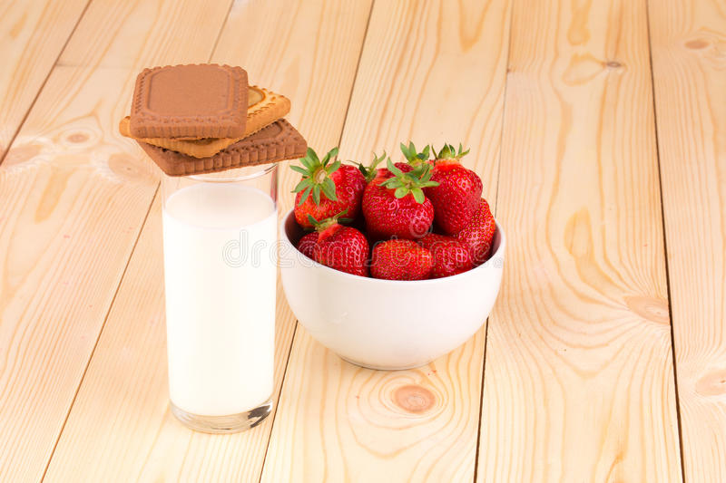 Fresh strawberry and milk in a glass royalty free stock photo