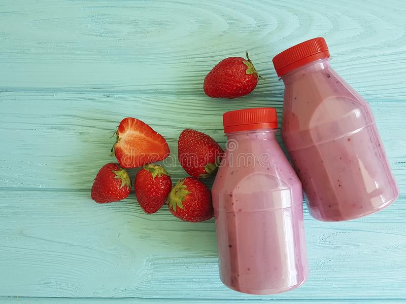 Fresh strawberry smoothies yogurt fruit nutrition on a blue wooden background stock photos
