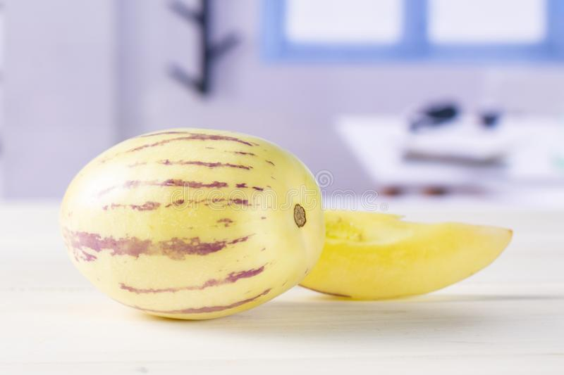 Fresh striped pepino melon with blue window stock images