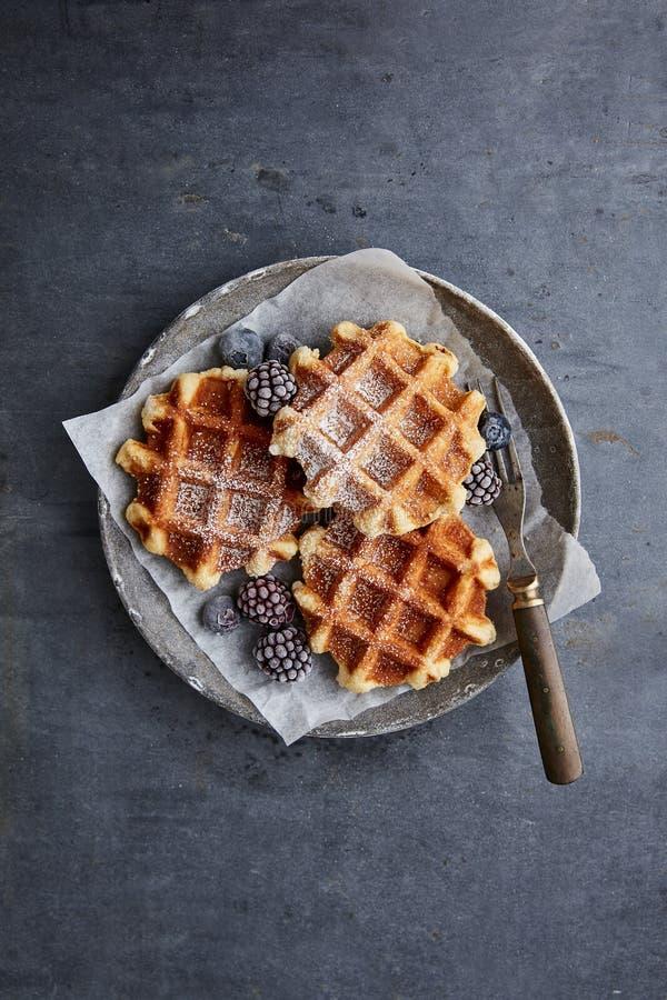 Sugar waffles with berries. Fresh sugar waffles with castor sugar stock photo