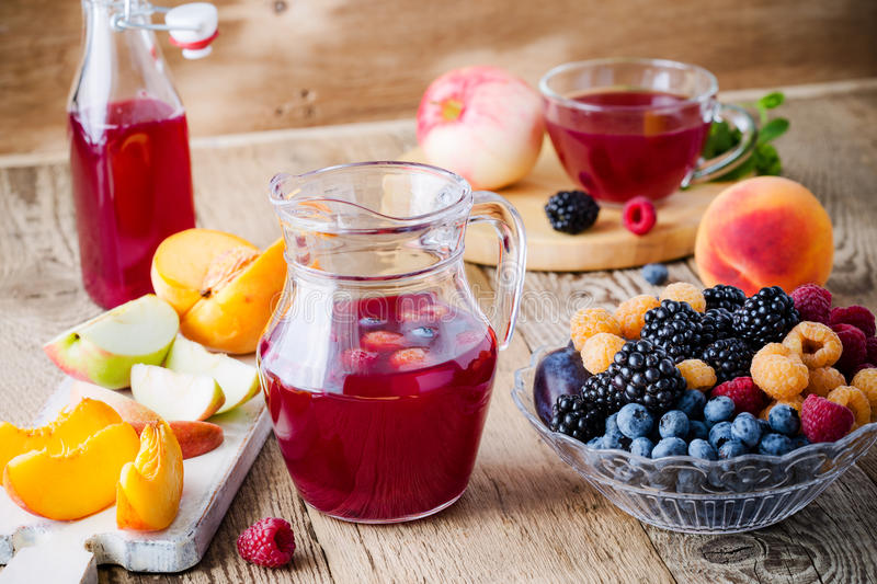 Fresh summer berries and fruits in glass bowl on wooden rustic royalty free stock photo