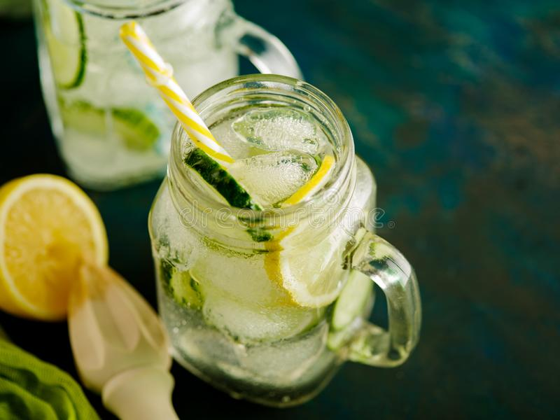 Fresh Summer Drink. Healthy detox fizzy water with lemon and cucumber in mason jar. Healthy food concept. stock images