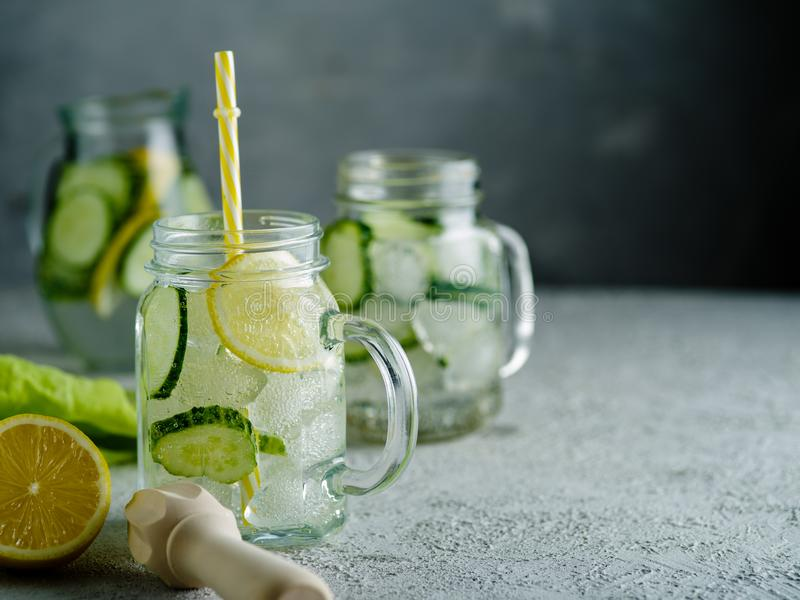 Fresh Summer Drink. Healthy detox fizzy water with lemon and cucumber in mason jar. Healthy food concept. stock photo