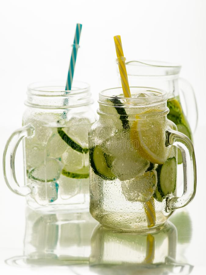 Fresh Summer Drink. Healthy detox fizzy water with lemon and cucumber in mason jar. Healthy food concept. royalty free stock images