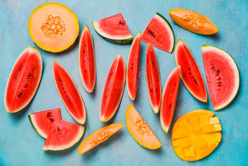 Fresh summer fruits. Fruits slices, watermelon and melon , mango. royalty free stock photography