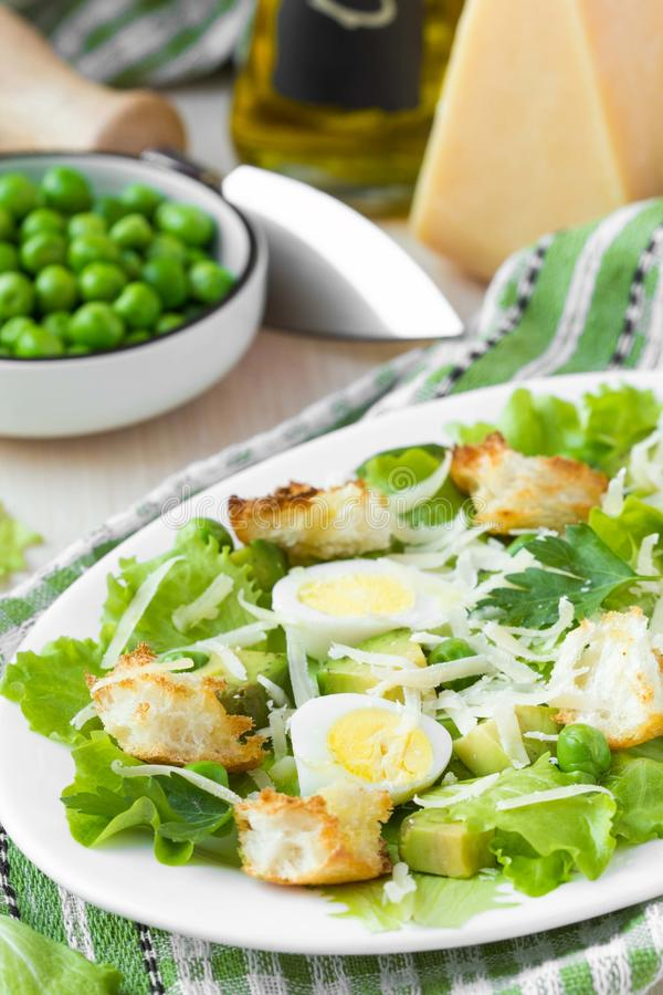 Fresh summer salad with lettuce, eggs, cheese, croutons, green royalty free stock photo