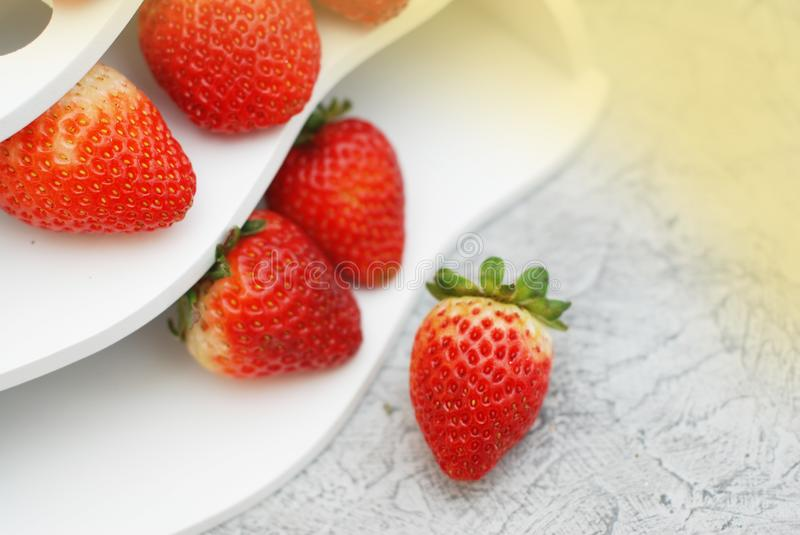 Fresh Summer Strawberries Isolated on Textured Gray Background. Fuits and Vitamines. Health Food Concept. Fresh Summer Strawberries Isolated on Textured Gray stock images