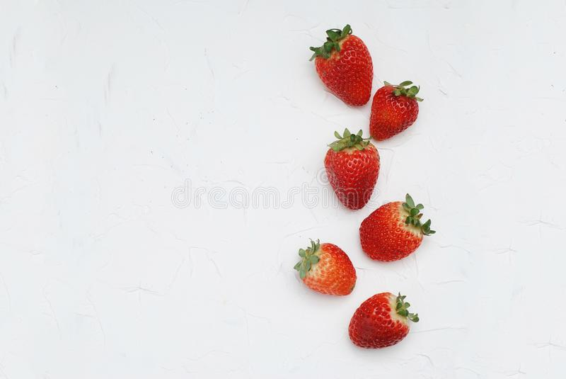 Fresh Summer Strawberries Isolated on Textured Gray Background. Fuits and Vitamines. Health Food Concept. Fresh Summer Strawberries Isolated on Textured Gray royalty free stock photography