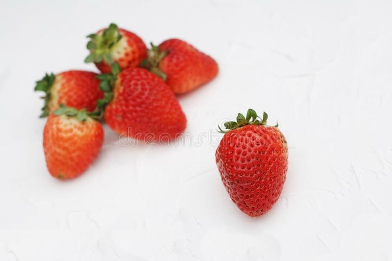 Fresh Summer Strawberries Isolated on Textured Gray Background. Fuits and Vitamines. Health Food Concept. Fresh Summer Strawberries Isolated on Textured Gray royalty free stock photo
