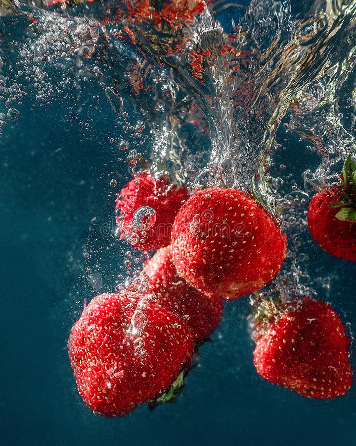 Fresh summer strawberries. Fresh strawberry. Strawberries in water. spray, berries, red and blue. still-life. background. abstraction. food. photo of food stock photos