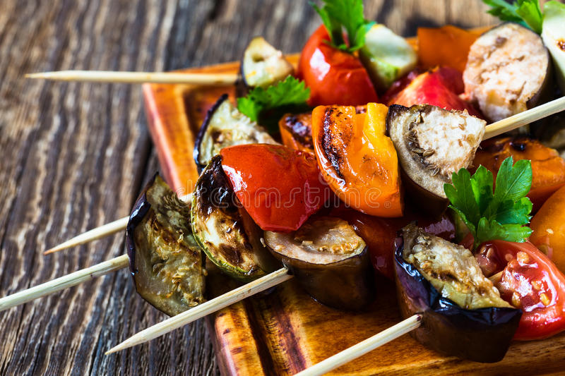 Fresh summer vegetable kebabs with eggplant and cherry tomatoe stock images