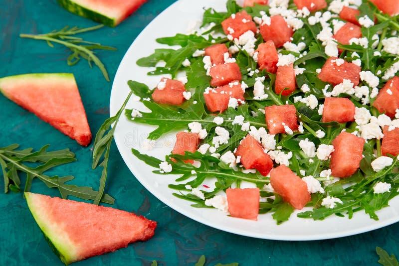 Fresh summer watermelon salad with feta cheese and arugula stock photography