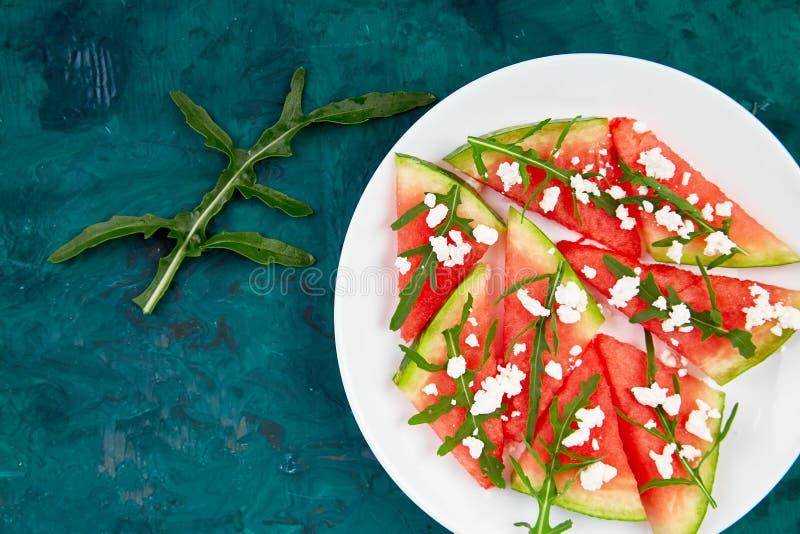 Fresh summer watermelon salad with feta cheese and arugula royalty free stock photos
