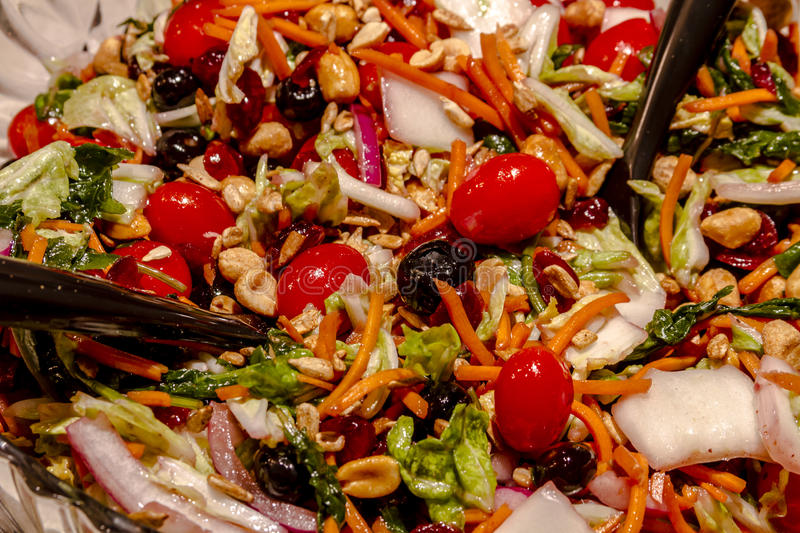 Fresh Super Food Salad with Dressing. Fresh organic super food salad with assorted raw vegetables, nuts and seeds with olive oil and red wine vinegar dressing stock photography