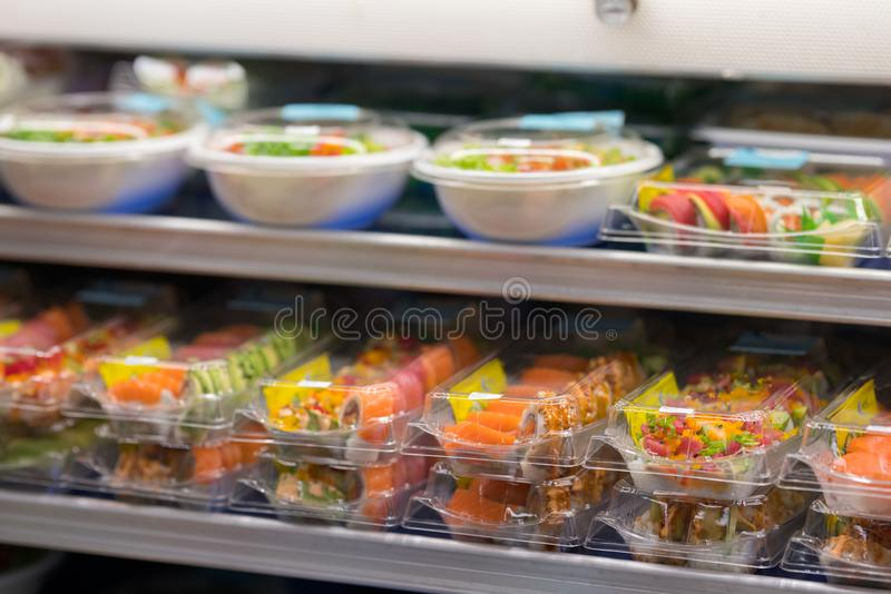 Fresh sushi for sale at a supermarket deli in togo containers royalty free stock image