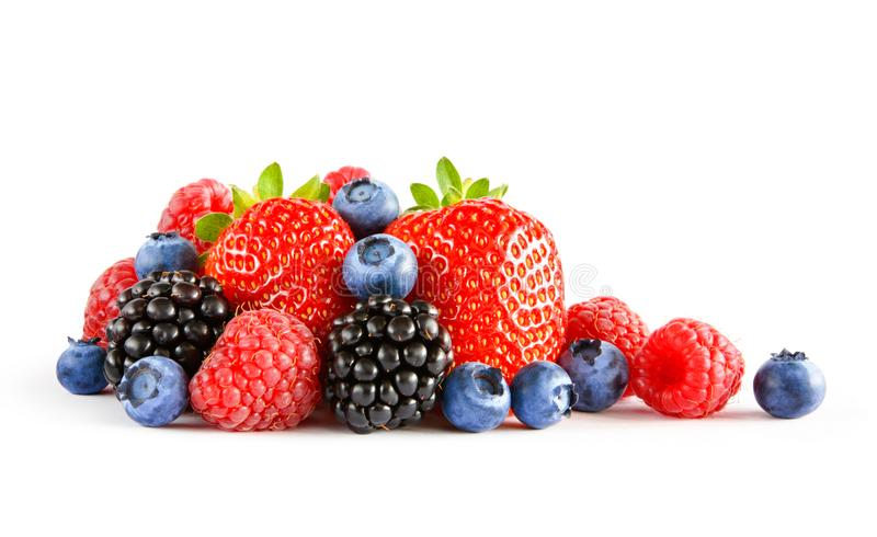 Fresh Sweet Berries on the White Background. Ripe Juicy Strawberry, Raspberry, Blueberry, Blackberry royalty free stock photo
