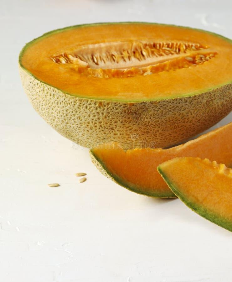 Fresh sweet cantaloupe melon. Fresh sweet cantaloupe melon on the white background stock image