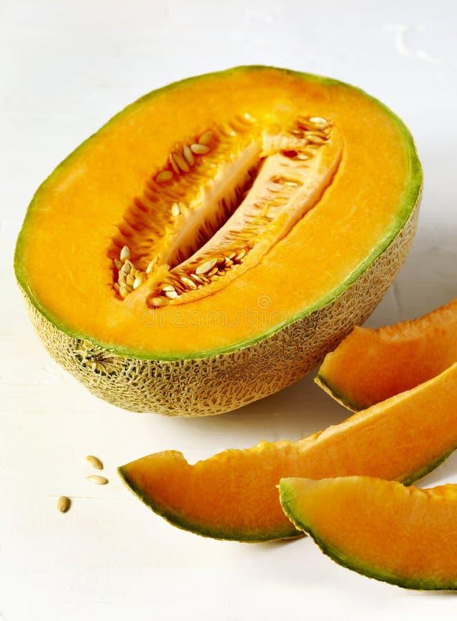 Fresh sweet cantaloupe melon. Fresh sweet cantaloupe melon on the white background stock images