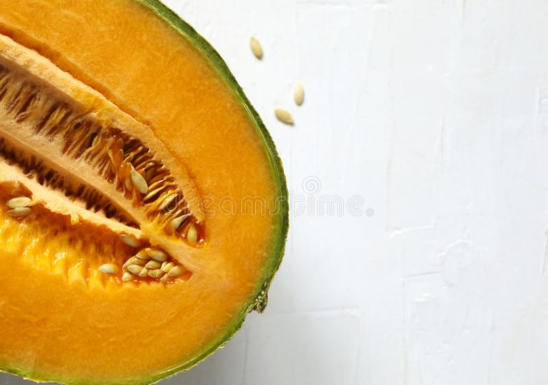 Fresh sweet cantaloupe melon on the white background. Fresh sweet cantaloupe melon on the white background, top view royalty free stock photography
