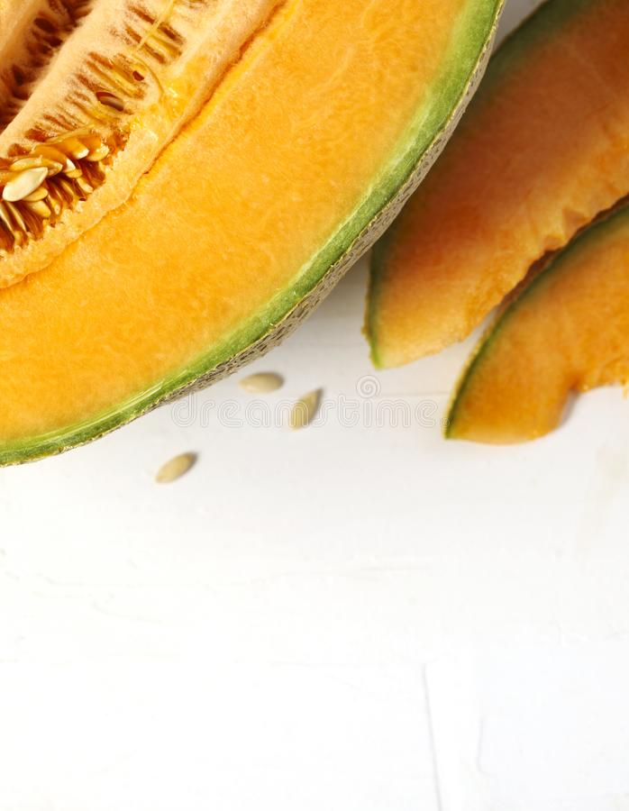Fresh sweet cantaloupe melon on the white background. Fresh sweet cantaloupe melon on the white background, top view stock photography