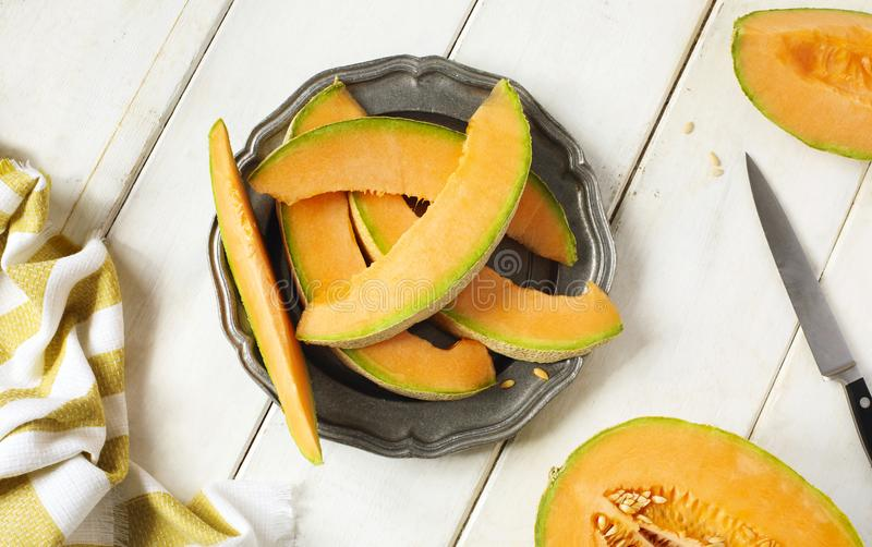 Fresh sweet cantaloupe melon on the wooden table. Fresh sweet cantaloupe melon on the wooden table, top view stock photos