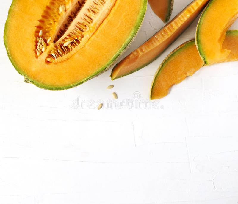 Fresh sweet cantaloupe melon on the wooden table. Fresh sweet cantaloupe melon on the wooden table, top view, copy space royalty free stock images