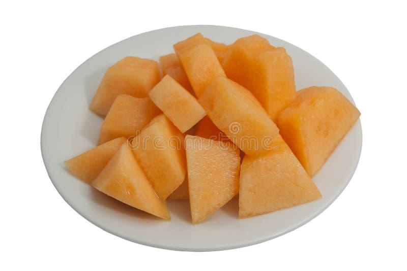 Fresh sweet cantaloupe on a plate. Fresh sweet cantaloupe on a plate, isolated on white background stock photography
