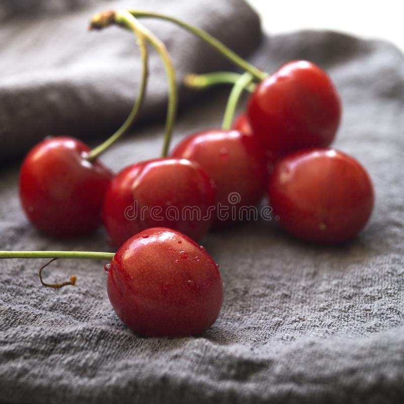 Fresh sweet cherries with water drops on the table. Close up stock image