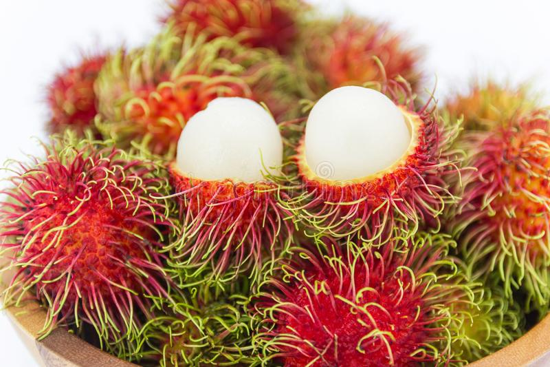 Fresh Sweet fruits rambutan in the wood cup royalty free stock photography