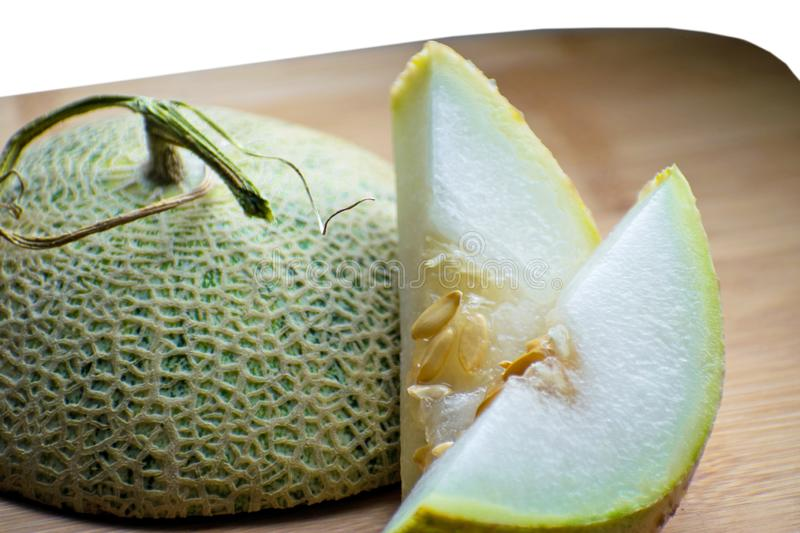 Fresh sweet green melon on the wooden board, tasty melons sliced on wooden board. Cantaloupe melon. Fresh sweet green melon on the wooden board. Cantaloupe royalty free stock image