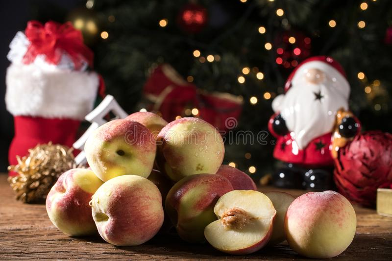 Fresh sweet group of sliced peaches in christmas background. Fresh sweet group of sliced peaches in christmas background royalty free stock photography