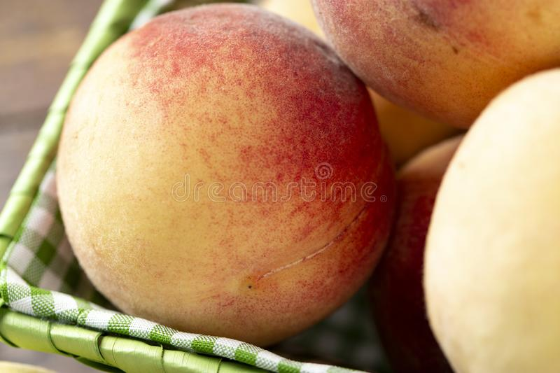 Fresh sweet peaches on the wooden table stock photos