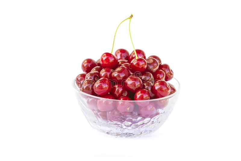 Fresh sweet red cherries in a glass bowl, ripe and juicy cherry fruit, healthy food, close-up, isolated on a white stock photo