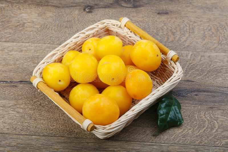 Yellow plums in the bowl royalty free stock photo