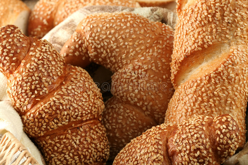 Fresh sweet rolls with sesame stock images