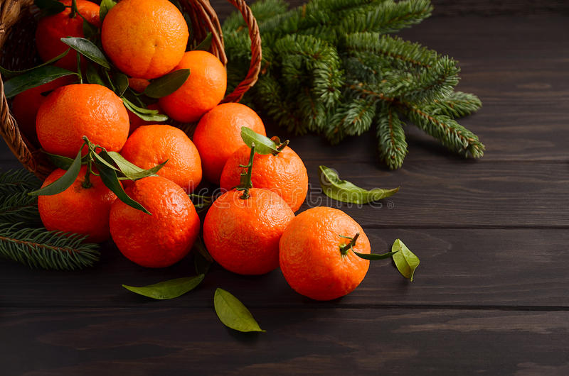Fresh tangerine clementine with spices on dark wooden background. Christmas concept, selective focus, horizontal, copy space royalty free stock photo