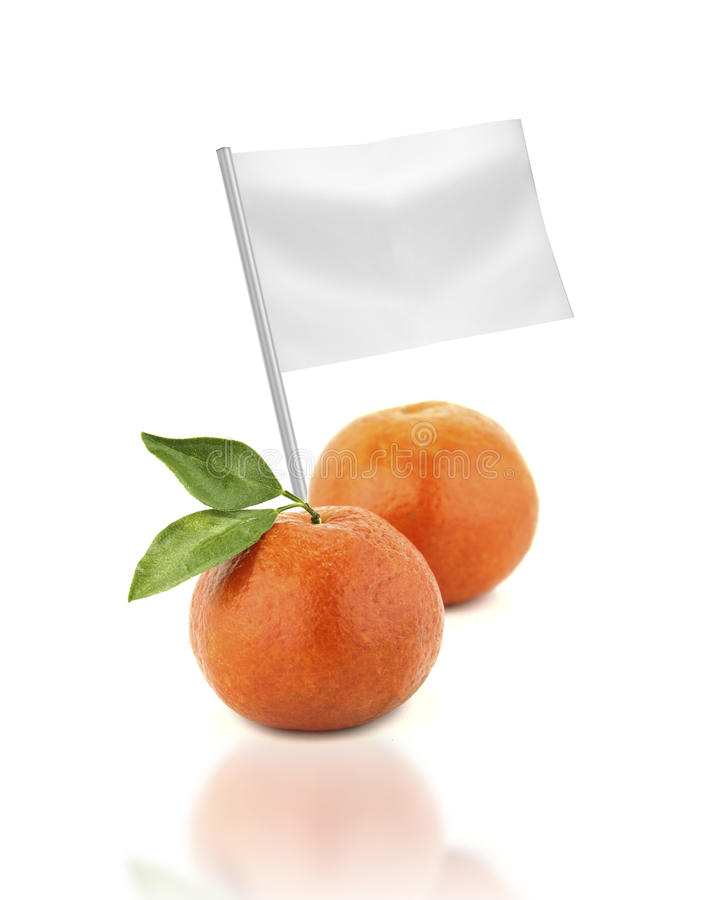 Fresh tangerine with flag. Healthy and organic food concept. Fresh tangerine with flag showing the benefits or the price of fruits stock photo