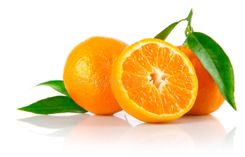 Fresh tangerine fruits with green leaves isolated stock photo