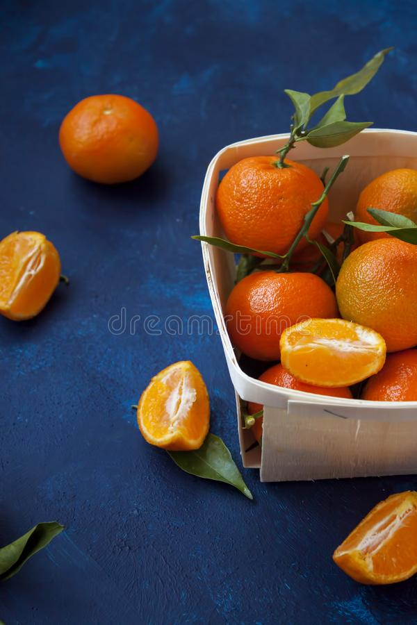 Fresh tangerines in basket royalty free stock photography