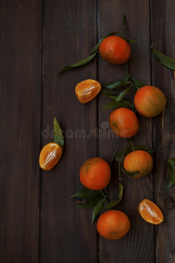 Fresh tangerines with green leaves royalty free stock photos