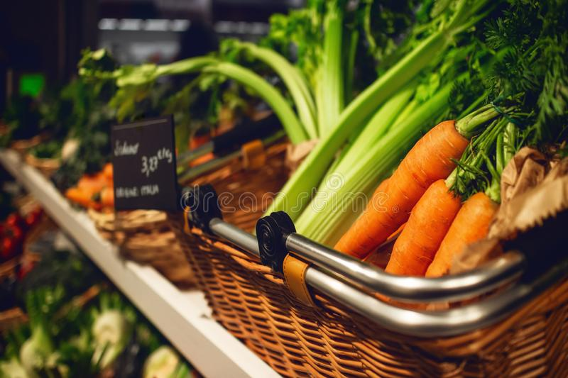 Fresh and tasty carrots, celery and salad on a market stall stock photo