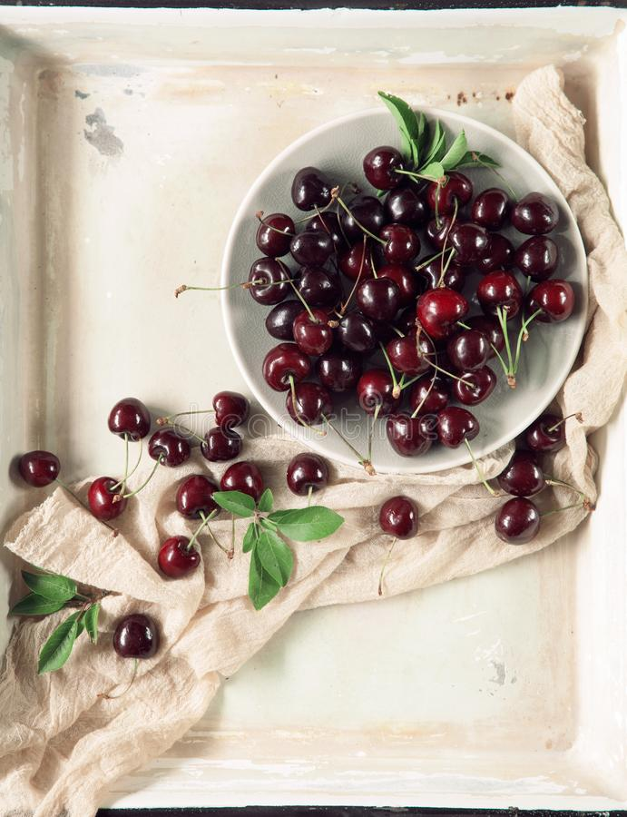 Fresh and tasty cherries, cherry from the market, decorated in a vintage baking tray, stock photography