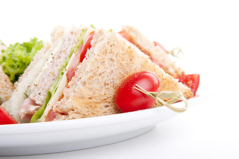 Fresh tasty club sandwich salad and toast royalty free stock images