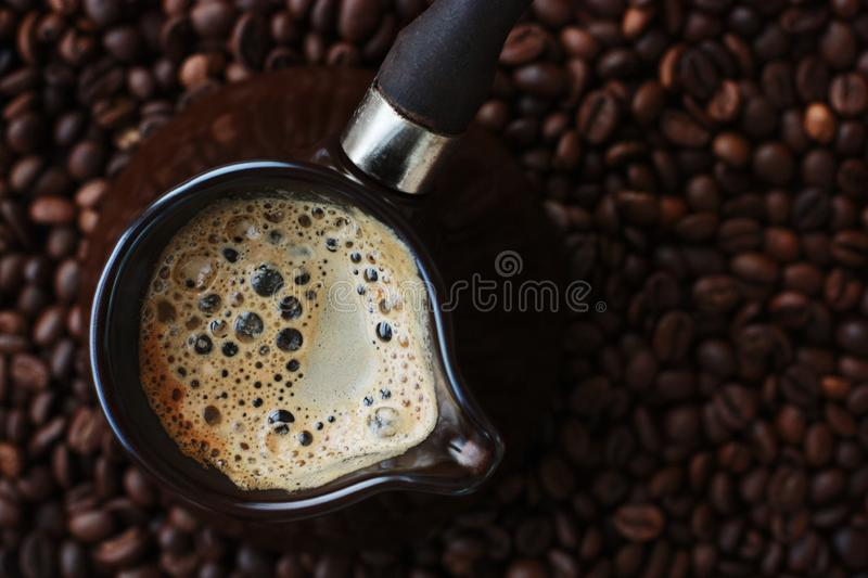 Fresh and tasty coffee in the Turka and coffee beans royalty free stock image