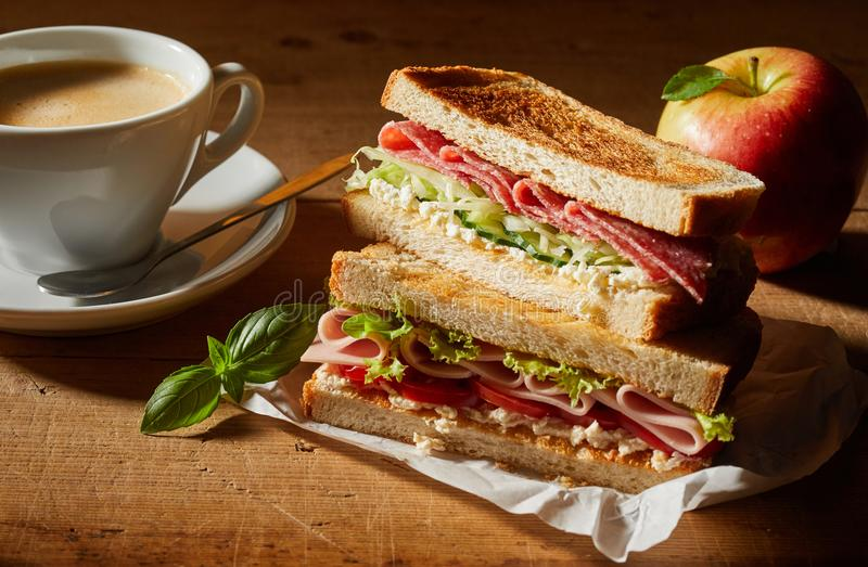 Fresh tasty double sandwich with coffee for lunch stock image